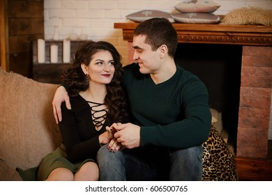 Beautiful couple close-angle pose for the camera. Woman and man looking at each other. Face to face.