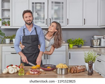 Beautiful couple cooking dinner