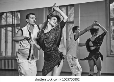 beautiful couple dancing bachata in dance studio