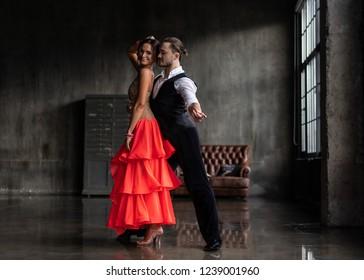 Beautiful couple dancing Latin dance