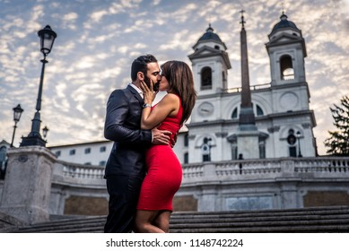 Beautiful couple dating in Rome, Italy -  Boyfriend and girlfriend kissing outdoors at Spagna Square and Trinita' dei Monti
