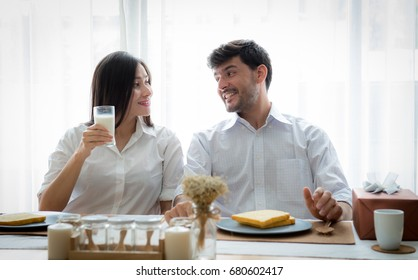Beautiful couple eating their breakfast at home, Happy family, Age 20-30 years.