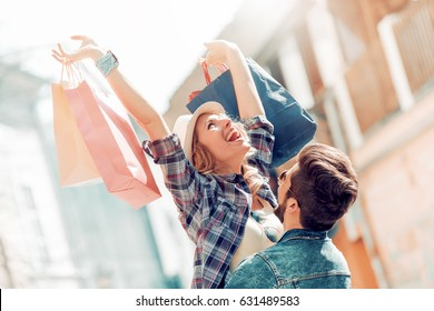 Beautiful couple enjoying shopping together in the city.