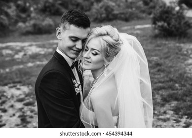 Beautiful couple enjoying themselves in their wedding at a mountain landscape