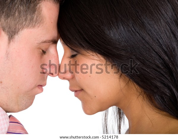 Beautiful couple with eyes closed while facing at each other