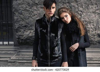 Beautiful couple in fashionable modern clothes in old town