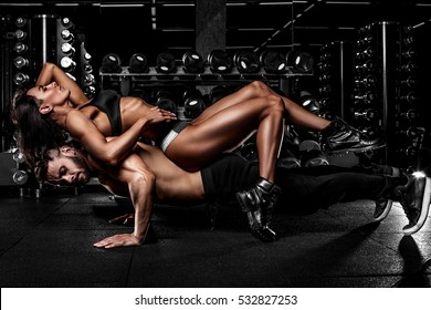 beautiful couple in the fitness gym