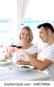 Beautiful couple having  romantic dinner at restaurant