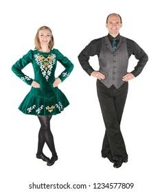 Beautiful couple in Irish dance green dress isolated on white