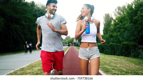 Beautiful couple jogging in nature
