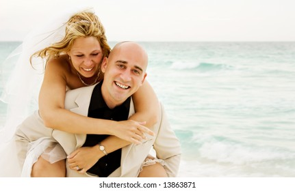 Beautiful couple just get married on the beach and having some fun