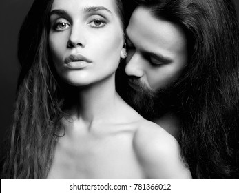 beautiful couple kiss. sexy woman and handsome man. lovely boy and girl. black and white portrait