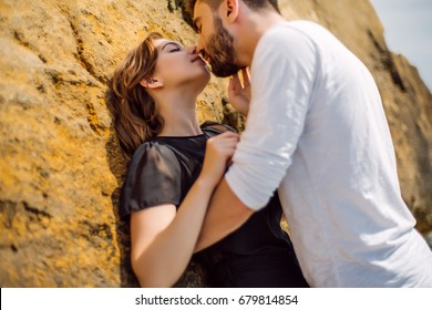Beautiful Couple Kissing at Beach.Outdoor portrait happy beautiful couple,couple having fun by sea,enjoy vacation,trendy hipster,happiness,love,relations,summer holidays,man holding girlfriend,tan