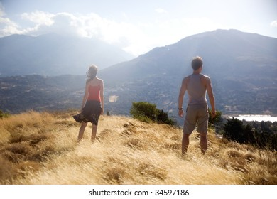beautiful couple looking at beautiful valley