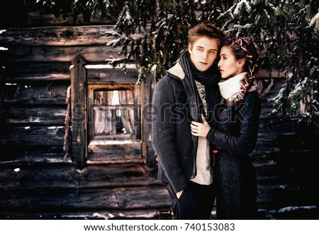 a4b5eec575f a beautiful couple in love in cozy knitted clothes is embracing against the  background of a