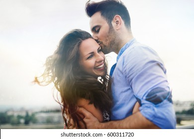Beautiful couple in love dating outdoors and smiling