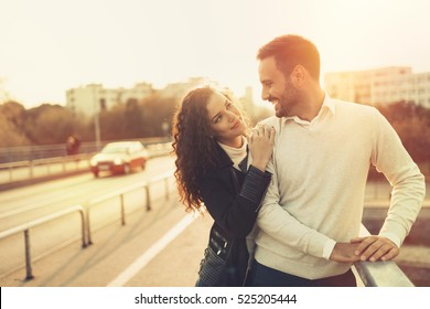 Beautiful couple in love hugging in city