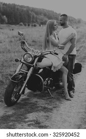 Beautiful couple in love on the chopper. Love is feeling, passion, traveling. Traveling alone, love.