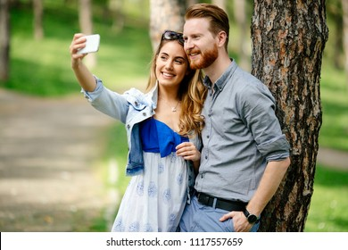 Beautiful couple in love taking slefies