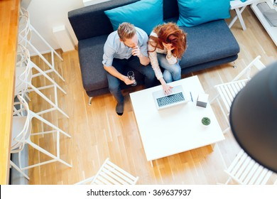 Beautiful couple in love working in a cosy living room