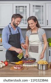 Beautiful couple making dinner