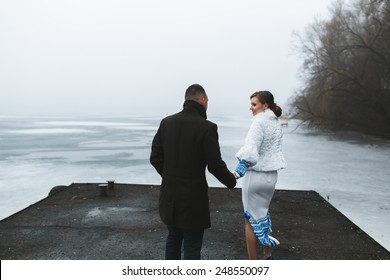 Beautiful couple on the dock in the winter fog.(ice preset)