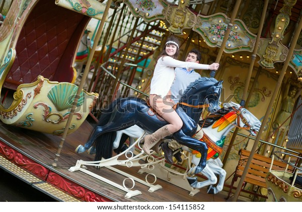Beautiful couple on a merry-go-round