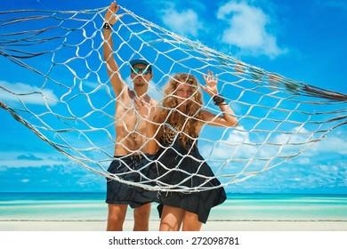 Beautiful couple on tropic beach