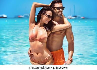 Beautiful couple on a tropical beach