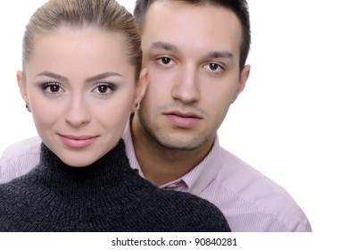 beautiful couple on white background posing