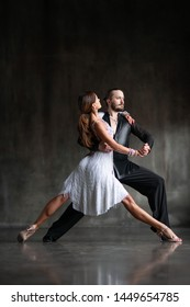 Beautiful couple passionately dancing tango
