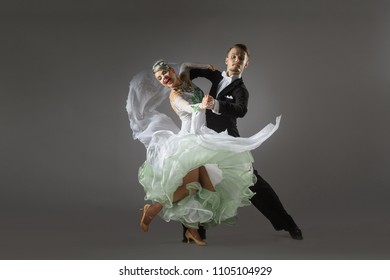 Beautiful couple of professional artists dancing passionate dance