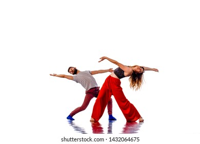 Beautiful couple of professional artists dancing passionate dance. Isolated over white