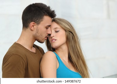 Beautiful couple ready to kiss with love and passion outside