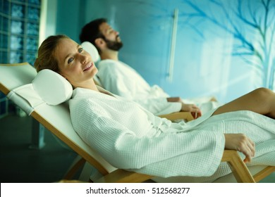 Beautiful couple relaxing in spa center