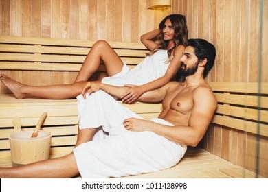 Beautiful couple relaxing in SPA sauna room