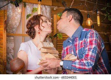 Beautiful couple in a rustic interior with flashlights