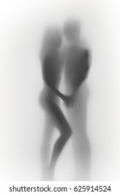 Beautiful couple silhouette together, behind a curtain