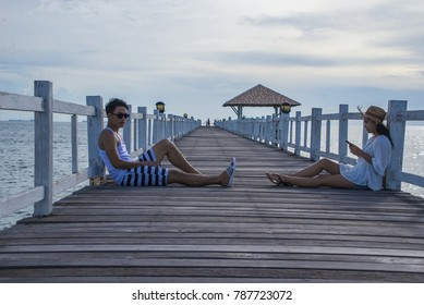 beautiful couple sitting on Wood bridge .Honeymoon romantic couple in love  and talking about Honeymoon trip