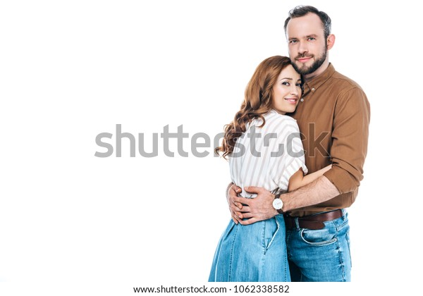 beautiful couple standing together and smiling at camera isolated on white