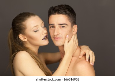 beautiful couple in studio portrait girl tenderly man posing to the camera