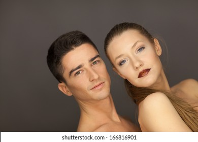 beautiful couple in studio portrait side view pose for the camera