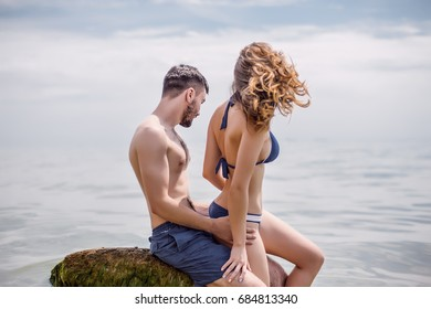 Beautiful couple in swimwear.Couple at sea beach.love concept,happy couple at summer, having fun at tropical beach,enjoy vacations,trendy swimsuit,happiness,relations,sunny summer day,tan,body care