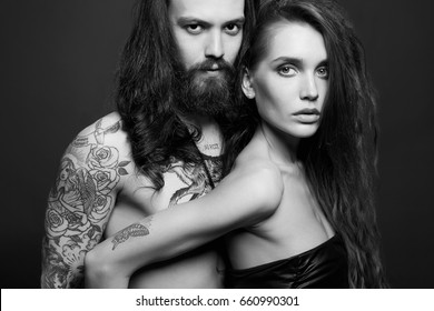 beautiful couple with tattoo.sexy woman and handsome man.lovely boy and girl