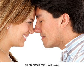 Beautiful couple with their heads together - isolated over a white background