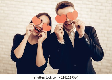 Beautiful Couple Together On Valentine's Day. Love Each Other. Romantic Holiday. Sweetheart's Celebration Concept. Young And Handsome. Feelings Showing. Cheerful Lovers. Origami Eyeglasses.