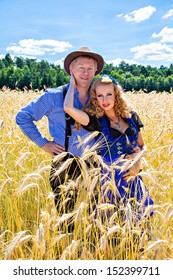 Beautiful couple in traditional Bavarian Tracht - Dirndl and Lederhosen