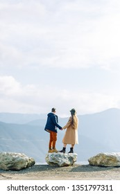 A beautiful couple travels in the mountains of Georgia. Lovestory in nature with a lake.