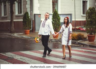 beautiful couple in Ukrainian brides walking around the city