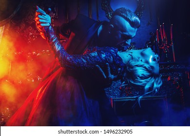 A beautiful couple of vampires dancing in interior. Classic style. Beauty, fashion.